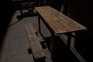 Old wooden table outside of a bar