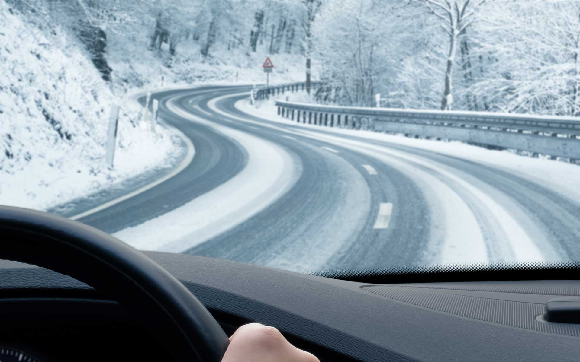 Driving on a curvy road in the winter with snow and possibly ice